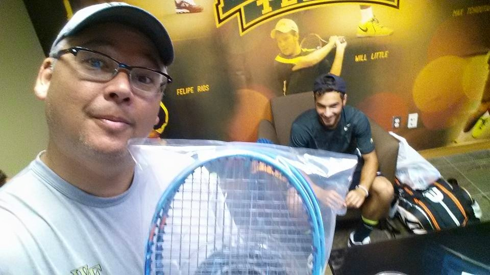 Selfie delivering rackets to the NCAA men's singles finalist